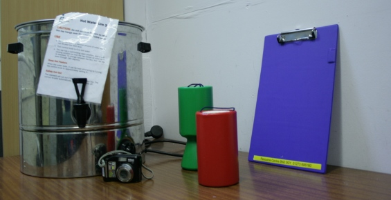 Water boiler, collecting tins, digital camera, clipboard